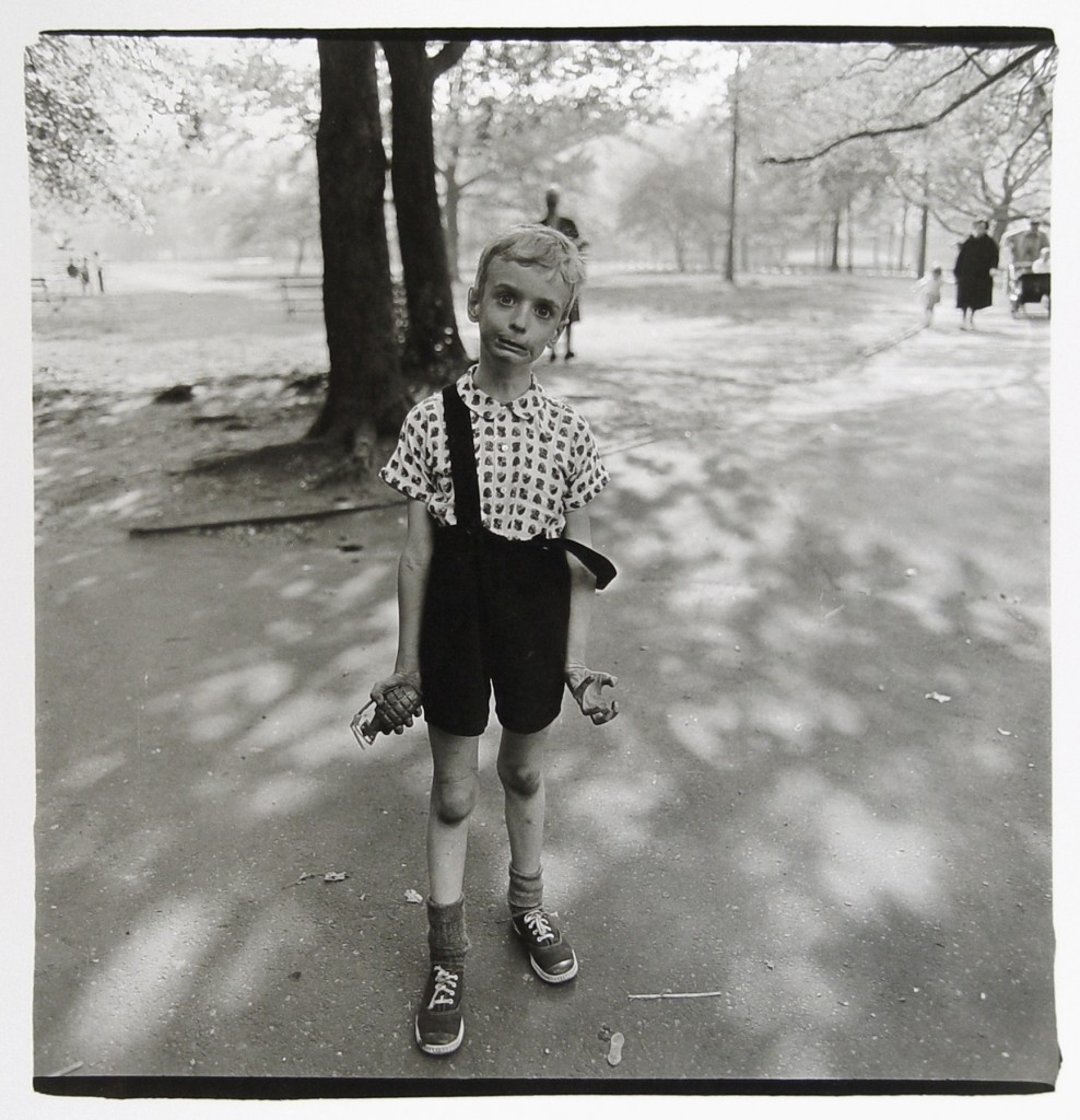 Child with a toy hand grenade in Central Park, N.Y.C. 1962