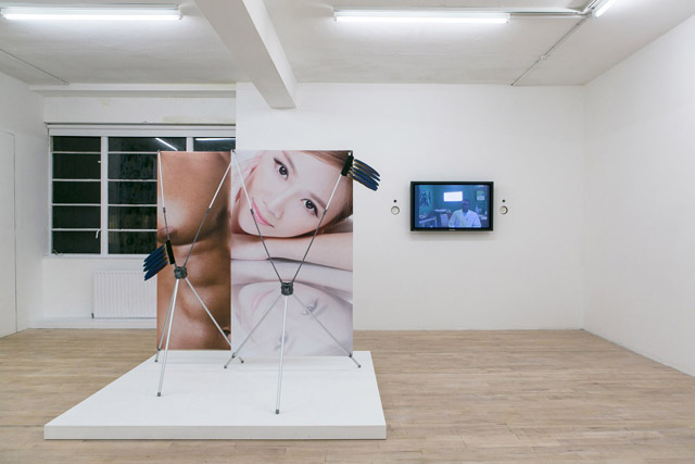 Timur Si-Qin, 'Deliver me from dipolar spirits' (2014); Neil Beloufa, 'Kempinski' video (2007). Fulfilment Centre installation view at The Sunday Painter (2014). Image courtesy the gallery.