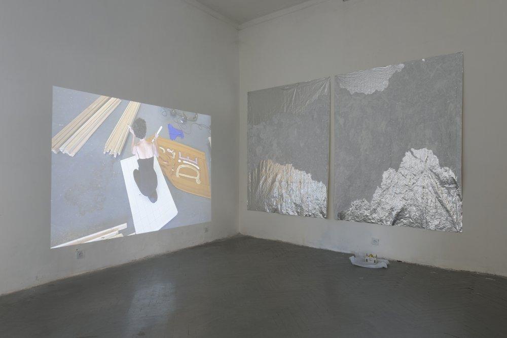 Left - right: Anna K.E, 'Enough Sugar' (2011), Imran Perretta, 'FSWAD' (2015). Installation view. Photo by Angus Leadley Brown. Courtesy Nectar Gallery, Tbilisi.