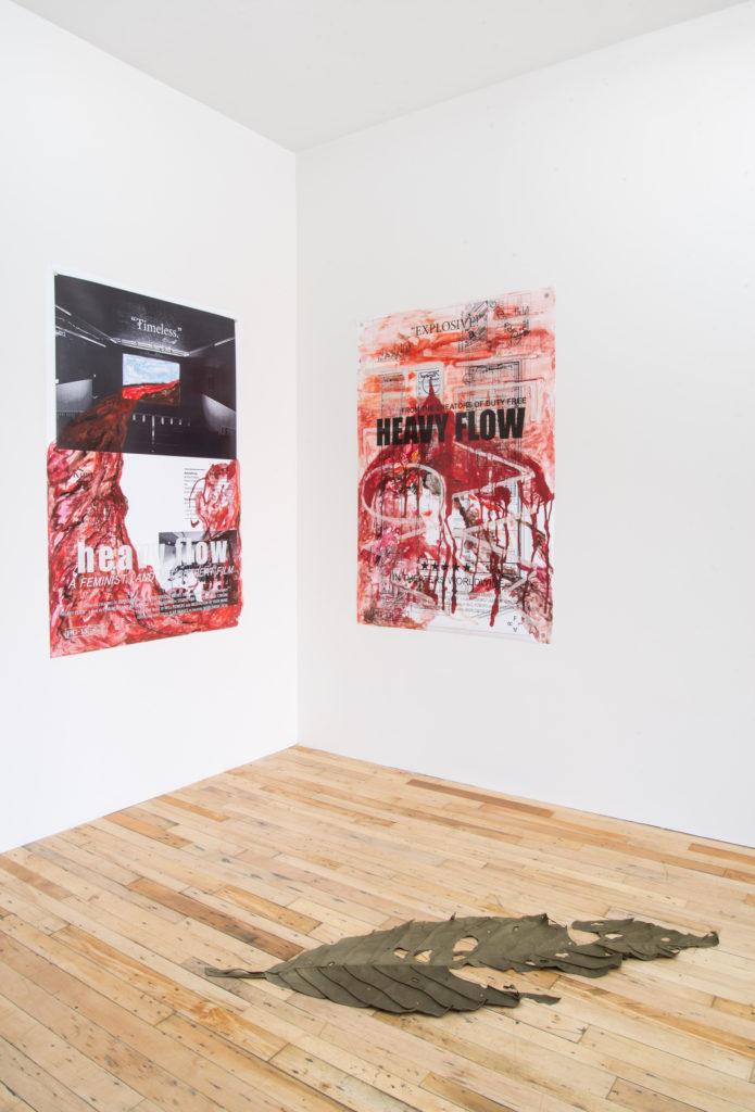 Right to left: Feminist Land Art Retreat, 'Heavy Flow Film Poster (Timeless)', 'Heavy Flow Film Poster (EXPLOSIVE)' (2016); Min Yoon, 'Untitled' (2016). Installation view. Courtesy JTT, New York.
