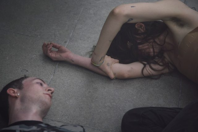 Eliza Douglas and Mickey Mahar in Anne Imhof's 'Angst II', (2016). Performance documentation. Courtesy the artist + Hamburger Bahnhof Berlin. Photo: Nadine Fraczkowski